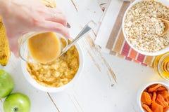 Granola preparation, white wood background Stock Image