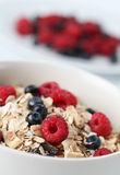 Granola with raspberries and blueberries Royalty Free Stock Photos