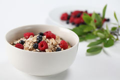 Granola with raspberries and blueberries Stock Photo