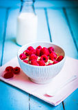 Granola with raspberries in a bowl on wooden background Stock Photography