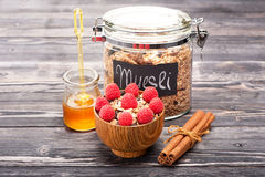 Granola with raspberries and honey Stock Image