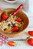 Granola with ripe strawberries in a bowl Stock Photos