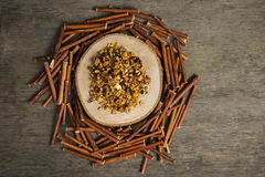 Granola. Served with cinnamon on wooden plate stock photography