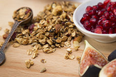 Granola. Served with fig and pomegranate stock photo