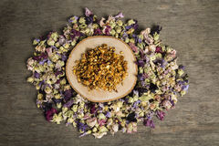 Granola. Served with flowers on the wooden plate royalty free stock photography