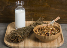 Granola. Served with milk on wooden plate stock image