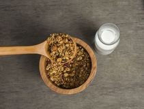 Granola. Served with milk on the wooden plate royalty free stock image