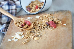 Granola spilling on wooden board Royalty Free Stock Photo