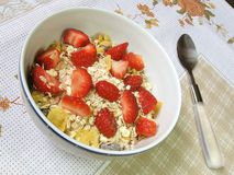 Granola and strawberries. A bowl of granola and strawberries on a floral towel stock images