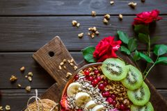 Granola, strawberry, cookies, rose on a black background royalty free stock photography