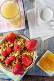 Granola  with strawberry and fresh juice. Stock Image