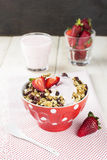 Granola with strawberry, nuts and yogurt on a wooden background.  Royalty Free Stock Photo