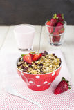 Granola with strawberry and yogurt on a white wooden background.  Royalty Free Stock Photos