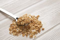 Granola superfood with almond and cashew nuts, dry fruits, raisins cherry in the ceramic jar on the white wooden table, top view,. Granola superfood with almond Stock Images
