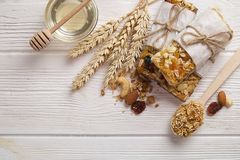 Granola superfood with almond and cashew nuts, dry fruits, raisins cherry in the ceramic jar on the white wooden table, top view,. Granola superfood with almond Royalty Free Stock Photo