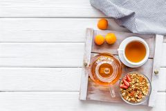 Free Granola, Tea And Fruit For Homemade Breakfast On The Tray On White Wooden Background Top View Copyspace Royalty Free Stock Photo - 154738705