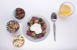 Granola topped with yogurt and portions of mixed nuts Stock Images