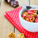 Granola in a white bowl. Food closeup Royalty Free Stock Photos