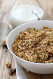 Granola in white bowl and milk Royalty Free Stock Photography