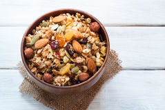 Granola in a wooden bowl. Royalty Free Stock Image