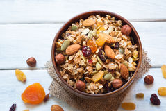 Granola in a wooden bowl. Royalty Free Stock Photo