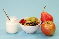 Granola with Yoghourt. Granola with fresh fruit and yoghourt on light blue background Stock Photos