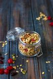 Granola with yoghurt, dried berries and pumpkin seeds Stock Photos