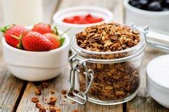 Granola with yogurt, nuts, goji berries and strawberries Stock Photography