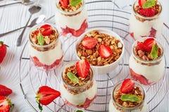 Granola .yogurt, strawberries in glass jars Royalty Free Stock Photo