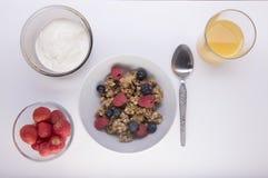Granola with yogurt, strawberries and orange juice Stock Photography