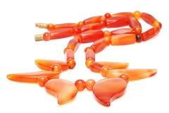 Granos ambarinos rojizos aislados Fotografía de archivo