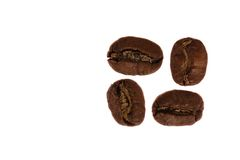 4 granos de café Imagenes de archivo