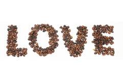 Granos de café asados en la forma de alfabetos, amor Foto de archivo