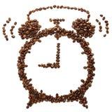 Granos de caf? asados formados como despertador de sonido foto de archivo libre de regalías