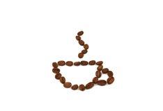 Granos de café bajo la forma de taza foto de archivo libre de regalías