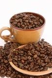 Granos de café con la taza y la placa Imagen de archivo libre de regalías