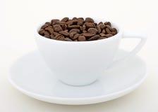 Granos de café - droga del estimulante para el hogar y la oficina fotos de archivo libres de regalías
