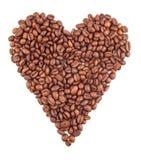 Granos de café en la dimensión de una variable del corazón Foto de archivo