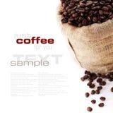Granos de café en saco de la lona Imagen de archivo libre de regalías