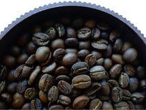 Granos de café en un pote Imagenes de archivo