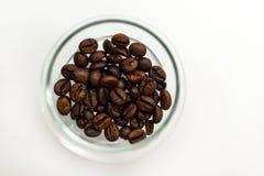 Granos de café en un vidrio Imagen de archivo