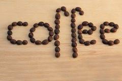 Granos de café en una madera Foto de archivo