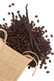 Granos de la vainilla y de café Foto de archivo