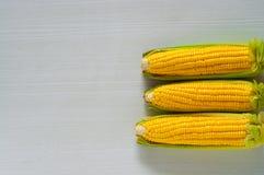 Granos del maíz con el primer de la gotita de agua Foto de archivo
