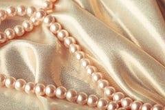 Granos en la seda Fotos de archivo libres de regalías