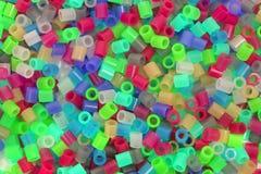 Granos plásticos coloreados Fotografía de archivo libre de regalías