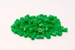 Granos plásticos verdes Foto de archivo