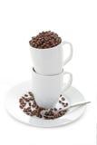 Granos y tazas de café Fotografía de archivo libre de regalías