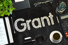 Grant Concept on Black Chalkboard. 3D Rendering. Royalty Free Stock Photos