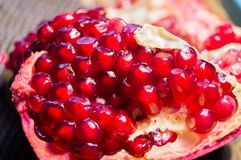 Grant. Exotic fruits. Ripe pomegranate. Pomegranate seeds. Red garnet. Grant close-up royalty free stock image